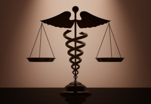 medical symbol with scales of justice